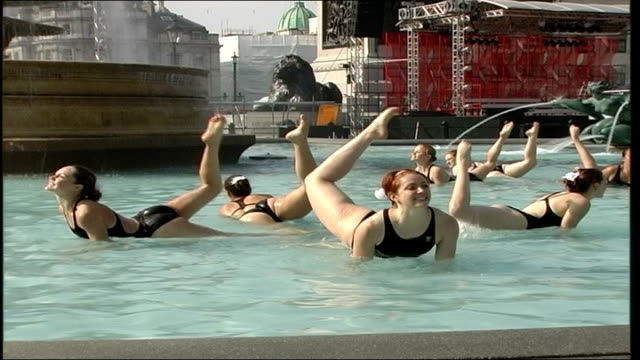 synchronised swimmers in trafalgar square fountains england london trafalgar square ext synchronised swimmers in black swimming costumes paddling in... - woman swimming costume stock videos & royalty-free footage