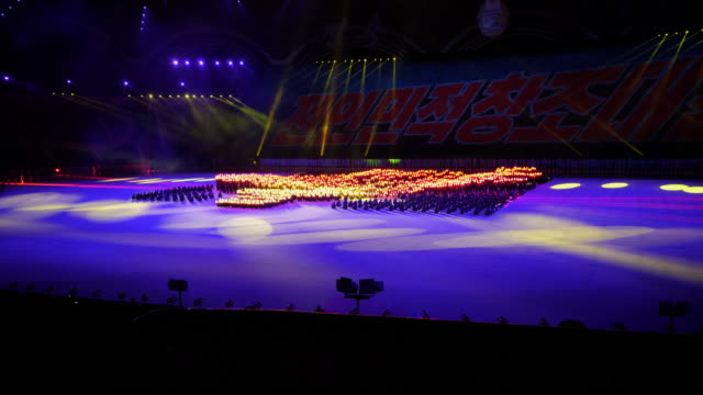 tl – synchronized crowd with torches perfoming during the mass games in pyongyang north korea dprk wide shot - spoonfilm stock videos and b-roll footage