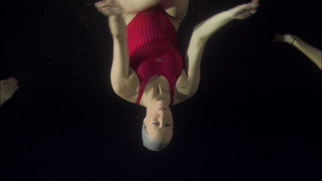 ms, synchronized swimmer underwater, basildon, essex, united kingdom - one piece swimsuit stock videos and b-roll footage