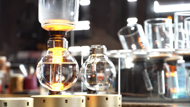 syphon coffee on gas stove - bar drink establishment stock videos & royalty-free footage