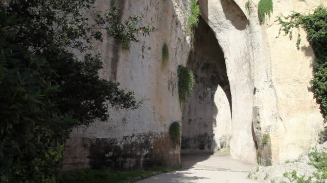 """syracuse, archaeological park, the cave """"ear of dionysius"""", 3rd century b.c. - 3rd century bc stock videos & royalty-free footage"""