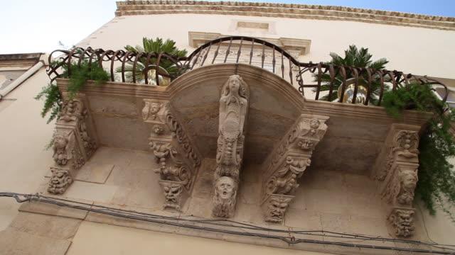 Syracuse, Ortygia, decorated balconies