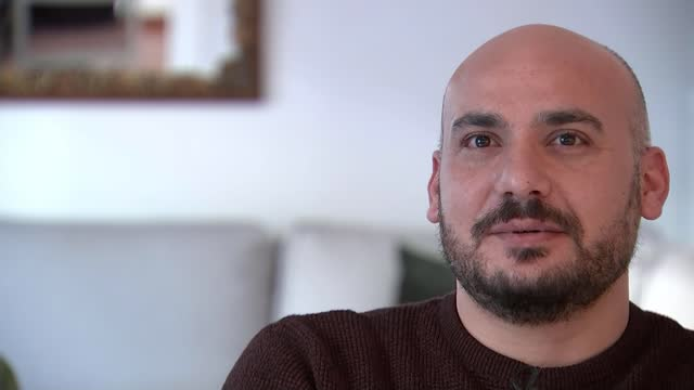 syria 10 years of war: refugee reflects on civil war anniversary; greece: athens: int abdo shikhi and wife renee set up shots with reporter /... - war and conflict video stock e b–roll