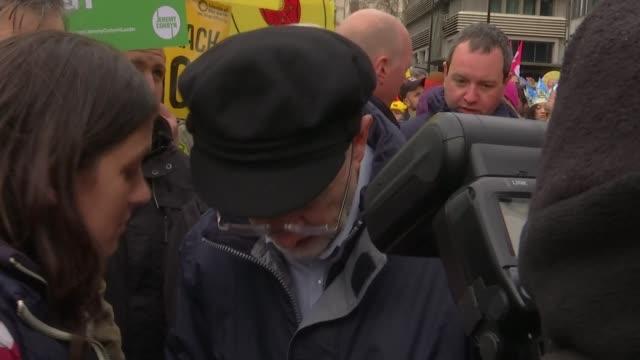 vídeos y material grabado en eventos de stock de jeremy corbyn undecided on free vote for labour mps england london jeremy corbyn mp signing autographs as attending climate change rally - autografiar