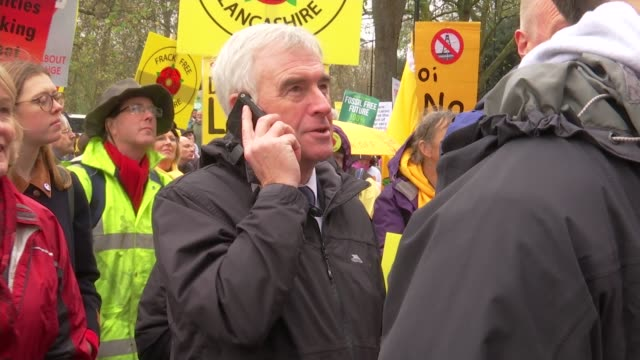 syria airstrikes debate: jeremy corbyn undecided on free vote for labour mps; ext john mcdonnell mp talking on mobile phone as standing amongst... - uncertainty stock videos & royalty-free footage