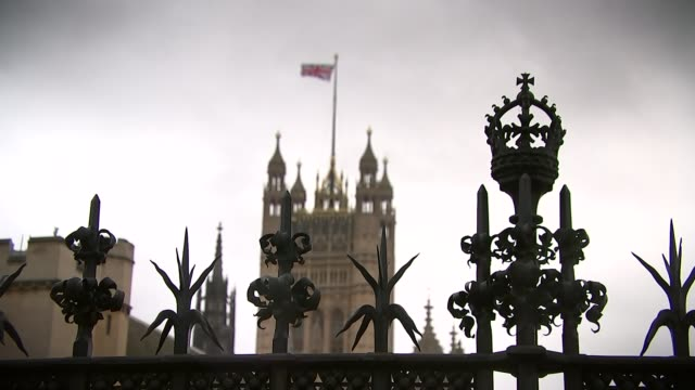 preview of vote date london victoria tower with union flag flying big ben clock tower tilt up bare tree branches with big ben clock face in... - victoria tower stock-videos und b-roll-filmmaterial