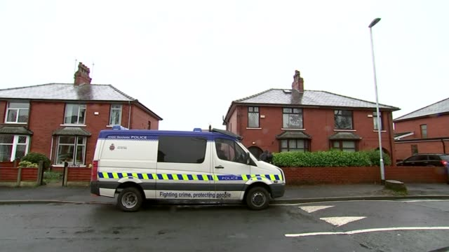 police search homes in greater manchester england greater manchester rochdale ext police van parked outside house ahmed family home with cars parked... - rochdale england stock videos & royalty-free footage