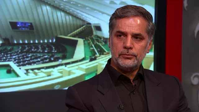 vídeos de stock, filmes e b-roll de iran agrees to take part in peace talks hossein naghavi hosseini interview sot syria is our first line of defence if we don't fight there we will... - vestimenta religiosa
