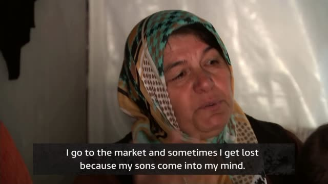 Syrian refugees living 'half lives' as the 'guests' of Gaziantep TURKEY Gaziantep EXT Town skyline Syrian refugee woman hanging out washing on...