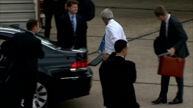 John Kerry arrival at Stansted Airport John Kerry along out of plane down stairway handshake and into car / Car holding John Kerry departs followed...