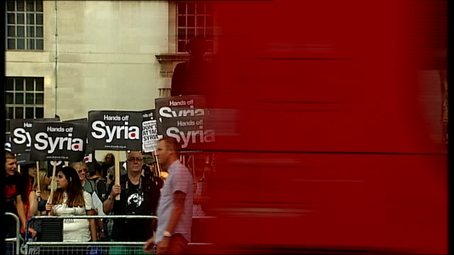 vídeos de stock, filmes e b-roll de stop the war protesters outside downing street england london ext general views of antiwar protesters with placards including 'hands off syria' and... - stop placa em inglês