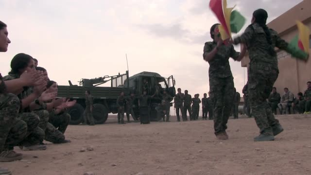 stockvideo's en b-roll-footage met syria. hasakah, 12th october, 2014. kurdish fighters of the people's protection units ypg and the women's protection units ypj dancing traditional... - military recruit
