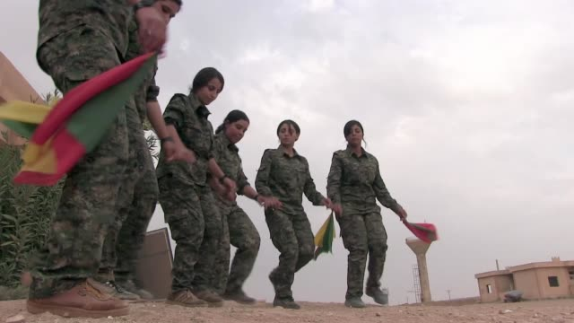 syria. hasakah, 12th october, 2014. kurdish fighters of the people's protection units ypg and the women's protection units ypj dancing traditional... - people's protection units stock videos & royalty-free footage
