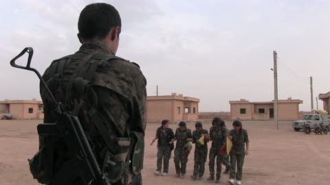 stockvideo's en b-roll-footage met syria. hasakah, 12th october, 2014. kurdish people's protection unit ypg and ypj fighters taking part in a military recruitment ceremony in al... - military recruit