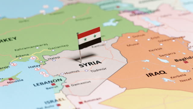 syrien mit nationalflagge - syrien stock-videos und b-roll-filmmaterial