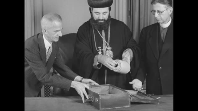 "syriac orthodox church archbishop athanasius yeshua samuel walking up steps to library of congress with officials / samuel standing between library... - newsreel ""dead sea scrolls video stock e b–roll"