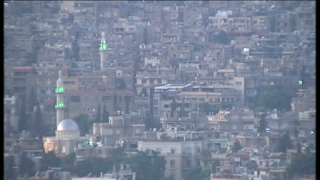 syrian ambassador rejects united nations condemnation giant poster of assad on wall of building high angle view of damascus houses including mosque... - poster stock videos & royalty-free footage