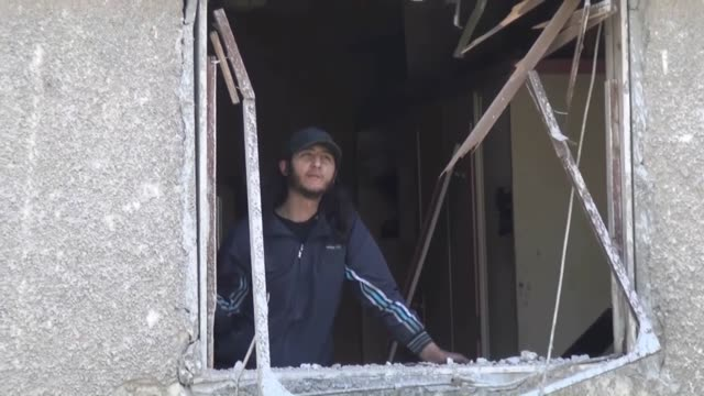 Syrian army forces have dropped more than 10 barrel bombs on Yarmouk refugee camp in Damascus Syria on 10 April 2015