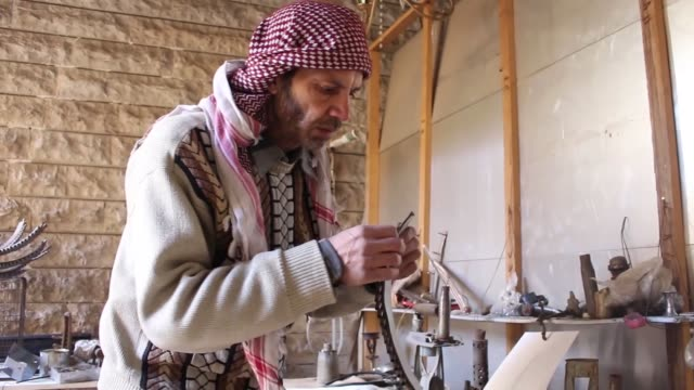 syrian artist mustapha ramadan who is also known as abu ali in his neighbourhood says that his goal is to convey syrian people's peace message to the... - leftovers stock videos & royalty-free footage
