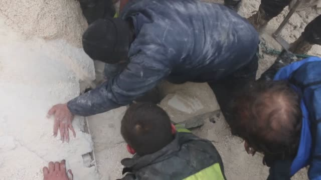 Syrian boy rescued from rubble at the scene of the car bombing attack targeting the opposition controlled Soran district of Aleppo Syria on December...