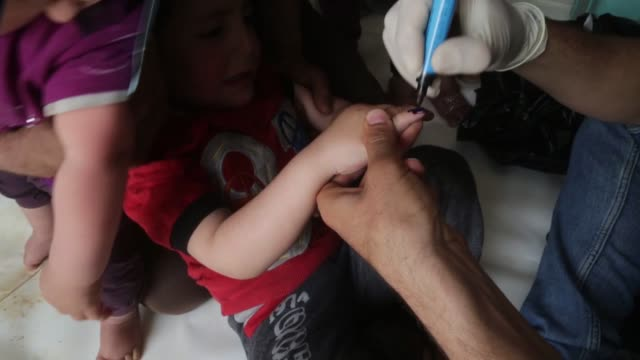 Syrian children are vaccinated during the measles campaign in AlBab district of Aleppo Syria on April 17 2018 Kids fled from Eastern Ghouta's Douma...