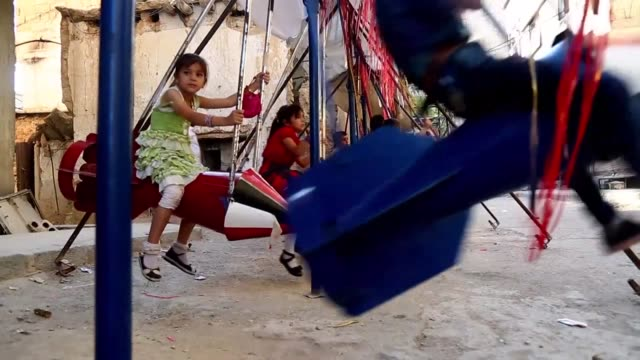 vídeos de stock, filmes e b-roll de syrian children love playgrounds like kids all over the world but in rebel held towns near damascus swing sets are made of spent rockets and jungle... - jungle gym