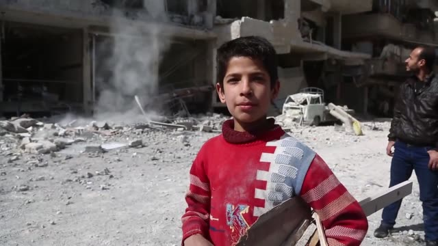 Syrian children Nouman Abdul Qayyum and Bessam speak to journalists in Syria's besieged Eastern Ghouta suburb of Damascus on March 02 2018 Activists...