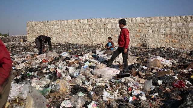 syrian children work in garbage dumps to provide financial support to their families in idlib's town of sinjar syria on november 19 2019 interviews... - unhealthy living stock videos & royalty-free footage