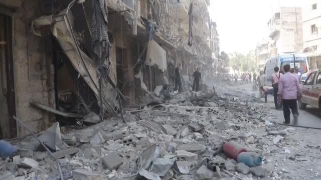 syrian civil defense members and civilians search for survivors in the rubble of buildings destroyed in the barrel bomb attacks of syrian regime... - mashhad stock videos & royalty-free footage