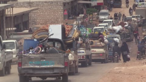 syrian civilians who fled their homes in idlib due to intensified shelling by the assad regime and its allies, shelter at idlib's kafr lusin refugee... - civilian stock videos & royalty-free footage