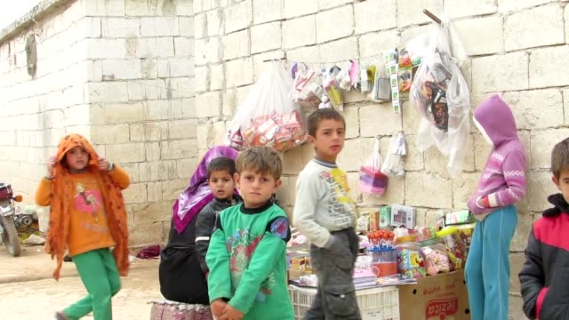 syrian families who fled from syrian army's attacks in hama settle in khalid bin waleed refugee camp in idlib syria on 27 november 2014 - refugee camp stock videos & royalty-free footage