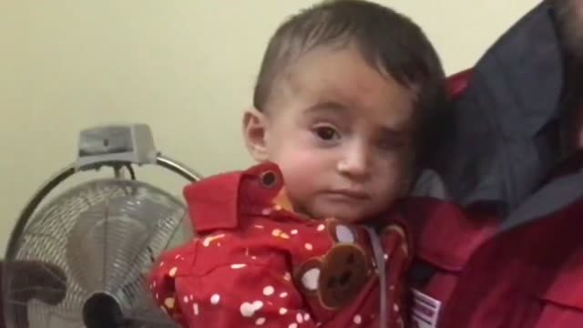 syrian infant who became a symbol of the plight of civilian victims of regime attacks finally reached safety in hatay southern turkey on sunday along... - red cross stock videos & royalty-free footage