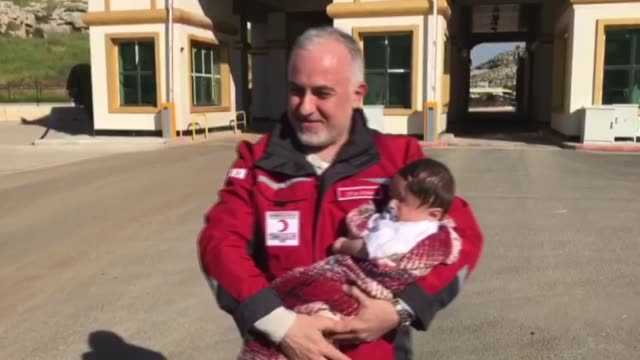 syrian infant who became a symbol of the plight of civilian victims of regime attacks finally reached safety in hatay, southern turkey on sunday... - red cross stock videos & royalty-free footage