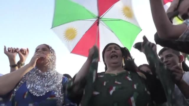 syrian kurds demonstrated on tuesday in the kurdish majority city of qamishli in support of a referendum on the independence of iraq's autonomous... - iraq stock videos and b-roll footage