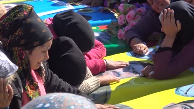 Syrian Kurds mourned Sunday in the northern town of Afrin during the mass funeral of fighters from the Kurdish People's Protection Units and the...