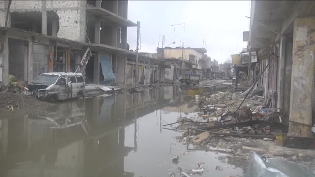 syrian kurds start to rebuild kobani after it has been freed from daesh militants in aleppo syria on 13 march 2015 shops start to serve again in... - rebuilding stock videos & royalty-free footage