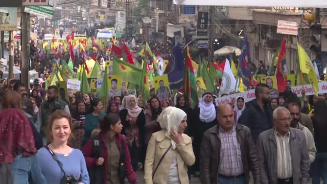 syrian kurds take to the streets in the city of qamishli in syria's northeastern hasakeh province to protest against the newly established joint... - verification stock videos & royalty-free footage