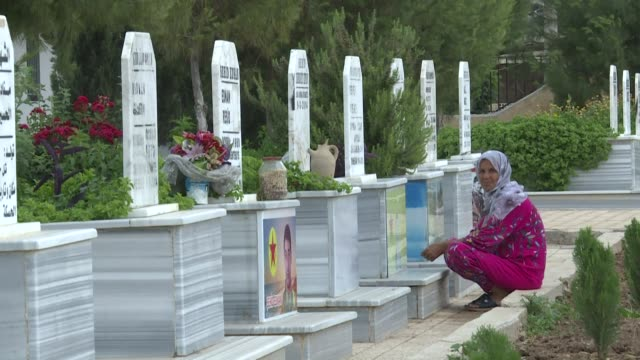 syrian kurds visit the graves of slain fighters with the syrian democratic forces on the eve of eid elfitr the muslim holiday which marks the end of... - fasting activity stock videos & royalty-free footage