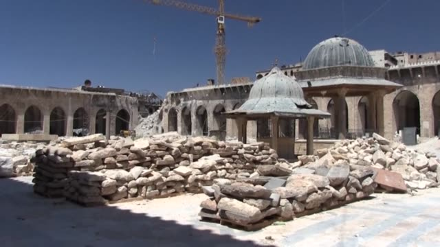 Syrian labourers take part in renovation work at the historic Grand Umayyad mosque in the northern Syrian city of Aleppo almost two years after...
