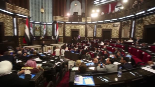 syrian lawmakers, some clad in masks due to the covid-19 coronavirus pandemic, attend the first meeting of the new parliament following the july 2020... - parliament building stock videos & royalty-free footage