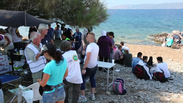 syrian migrants are cared for by volunteer charity workers on the greek island of lesvos. - isil konflikt stock-videos und b-roll-filmmaterial