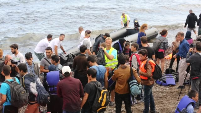 syrian migrants fleeing the war and escaping to europe, landing on the greek island of lesvos on the north coast at efthalou. up to 4,000 migrants a day are landing on the island and overwhelming the authorities. they are traficked by illegal turkish peopl - refugee stock videos and b-roll footage