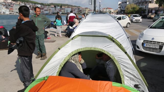 syrian migrants fleeing the war and escaping to europe, who have landed on the greek island of lesvos on the north coast at efthalou and made their way to mytilini. up to 4,000 migrants a day are landing on the island and overwhelming the authorities. they - military exercise stock videos & royalty-free footage