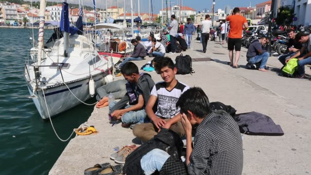 syrian migrants fleeing the war and escaping to europe, who have landed on the greek island of lesvos on the north coast at efthalou and made their way to mytilini. up to 4,000 migrants a day are landing on the island and overwhelming the authorities. they - isis stock videos and b-roll footage