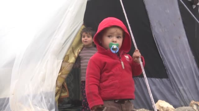 Syrian Mohammad Haci who fled Aleppo a month ago with his wife brother and four children due to the attacks of Syrian regime forces takes shelter in...