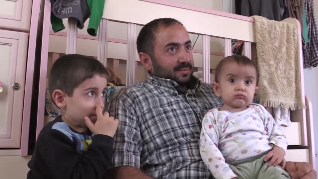 syrian mohammad recep speaks at an interview in hatay's reyhanli district southeastern turkey on april 07 2018 a syrian father has been living in... - hearing impairment stock videos & royalty-free footage