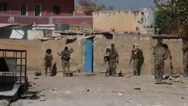 syrian national army members launch an operation in syria's ras al-ayn rural after the city center was cleared of pkk terrorists and the syrian... - militante gruppe stock-videos und b-roll-filmmaterial