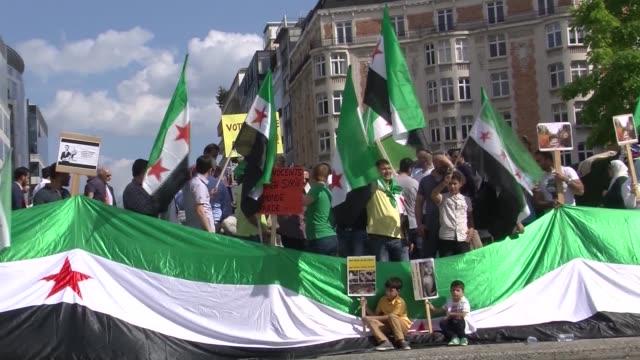 syrian opponents gather in front of eu council building to mark the second anniversary of ghouta chemical attack in brussels, belgium on 21 august,... - chemical stock videos & royalty-free footage