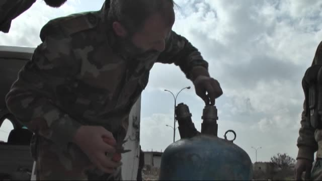 syrian opposition group islamic front members make preparations and launch attacks with howitzers made by propane cylinder and named 'hell' against... - cylinder stock videos & royalty-free footage