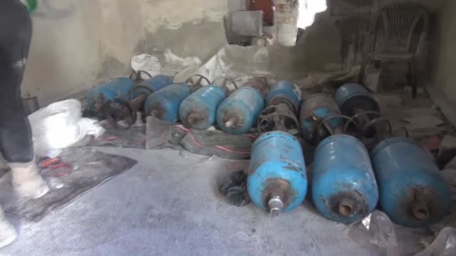 syrian opposition members make handmade ammunition named 'hell' and made of propane cylinder as they get prepared to launch attacks against assad... - cylinder stock videos & royalty-free footage